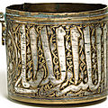 A mamluk silver-inlaid brass cylindrical vessel, egypt or syria, 13th century