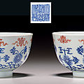 A fine pair of iron-red-decorated blue and white bowls, daoguang seal marks in underglaze blue and of the period (1821-1850)