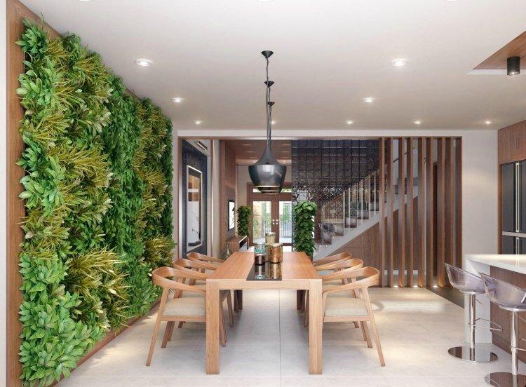 table-chaises-salle-manger-bois-mur-végétal-intérieur