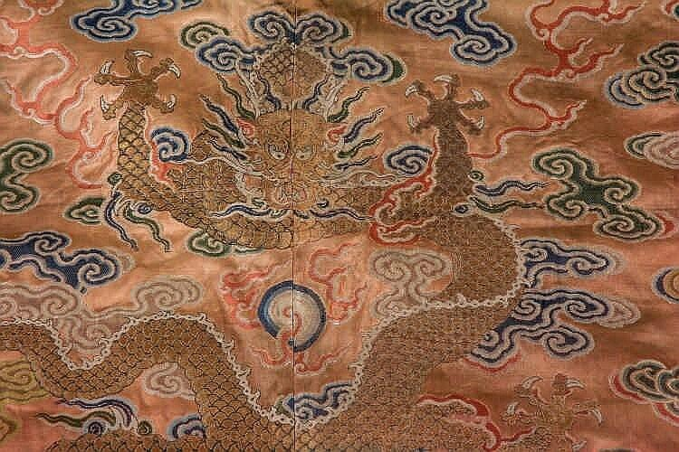 A coral ground silk Tibetan chuba, tailored from 18th century Chinese kesi3