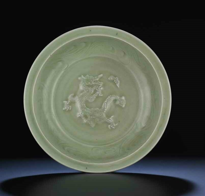 A Longquan celadon carved and moulded 'Dragon' dish, Late Yuan-Early Ming dynasty, 14th century