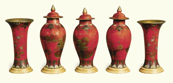 A Berlin faience garniture of five vases, three with covers, mid-19th century