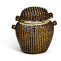 A rare brown-glazed 'basket-weave' jar and cover, Song dynasty (960-1279)