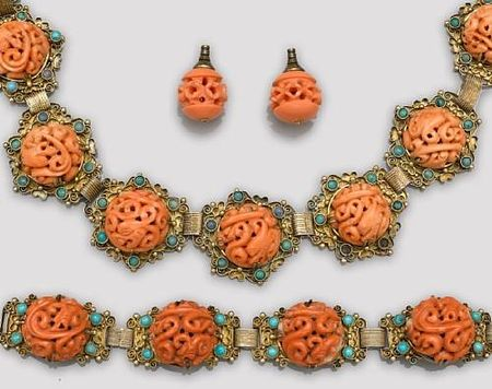 A_gilt_metal_filigree_necklace_and_bracelet_with_reticulated_coral_bead_inlay