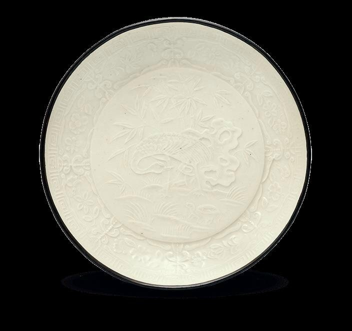 A rare moulded Ding 'tortoise and crane' dish, Jin dynasty (1115-1234)