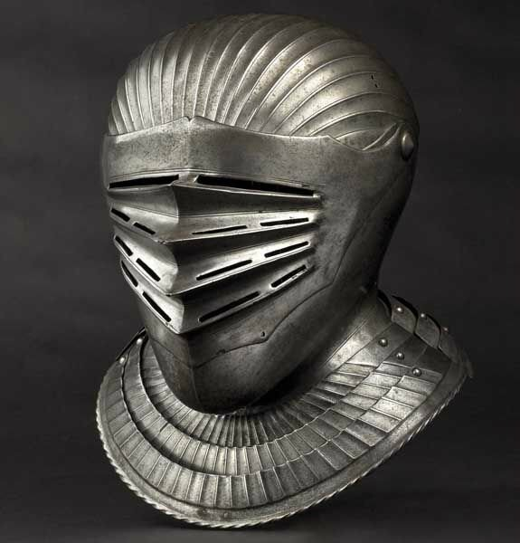 A South German Maximilian style close helmet for a fluted suit of armour, circa 1530