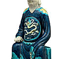 A blue-and-yellow-glazed figure of a seated official, china, ming dynasty (1368-1644)