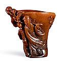 A rhinoceros horn 'Scholar' libation cup, Ming dynasty, 16th-17th century