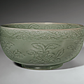 A rare carved longquan celadon deep bowl, ming dynasty, early 15th century