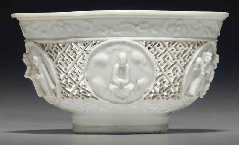 A small biscuit-decorated white-glazed reticulated bowl, Ming dynasty-early 17th century