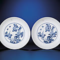 A fine and rare pair of blue and white 'peony' dishes, yongzheng six-character marks within double-circles and of the period